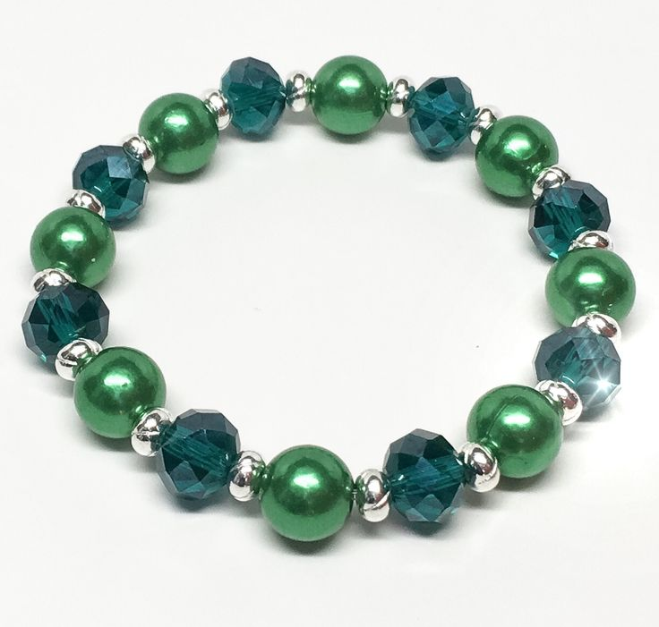 Elastic crystal cut glass and imitation pearl plus size bracelet with silver coloured spacer beads.