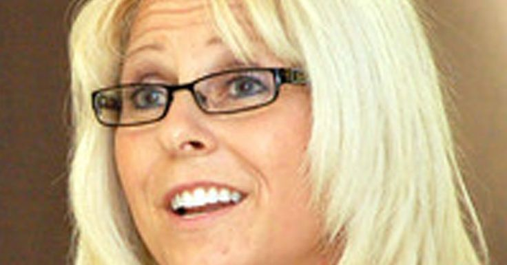 An administrative judge has upheld the dismissal of Sharon Helman, the Phoenix director, finding misconduct to support her ouster but saying the department did not prove that she was responsible for delays in care.