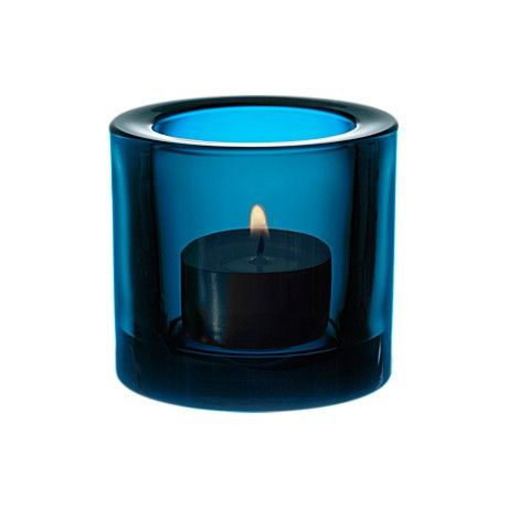 Iittala Turquoise Kivi Tealight Holder: The Kivi range of tea light holders, designed by Heikki Orvola, are small, colourful jewels of light. The colours and thickness of the glass enriches the glow as it multiplies the flickers of the flame. The wide range of colours to choose from lets you create a personal combination for every season and occasion of the year.