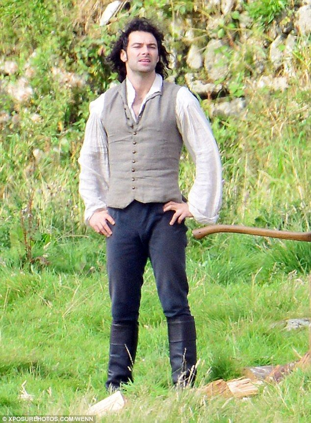 He's kept his shirt on: Aidan Turner reprised his role as the brooding Ross Poldark on the set of the next series of hit BBC drama Poldark in Cornwall this week