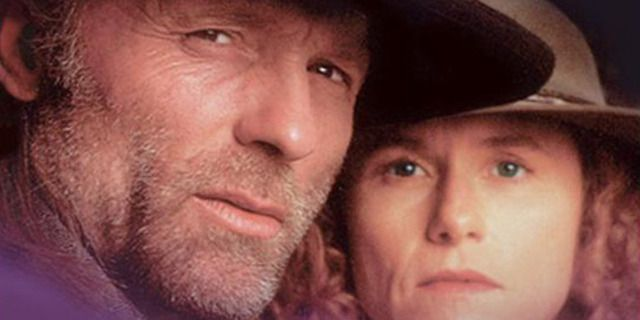 Ed Harris and Amy Madigan in RIDERS OF THE PURPLE SAGE