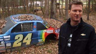Dale Earnhardt Jr. with Jeff Gordon car. Car's been retired to Earnharts car graveyard