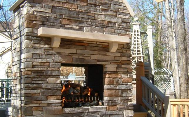 This see-through outdoor fireplace can be enjoyed by everyone on the deck!