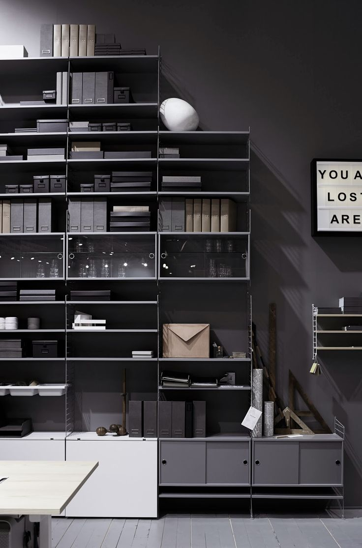 grey painted wall with shelving unit