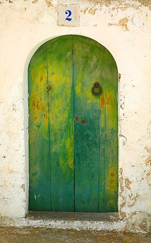 Door to a house on Puig de Missa, the house with the green door. Santa Eulalia, Ibiza, Spain. by chas.eastwood, via Flickr