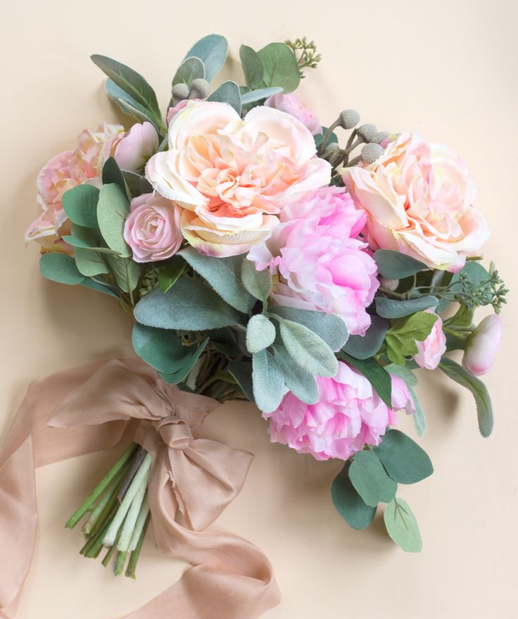 How to Choose Your Wedding Flowers.  Learn how to decide which artificial wedding flower to use when planning your wedding.  Afloral.com offers high-quality silk and real touch florals for your faux flower arrangements.