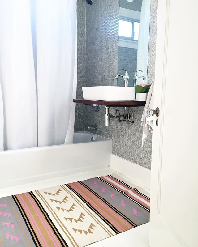 I'm starting to perk up our guest bathroom with a fresh coat of white paint on…