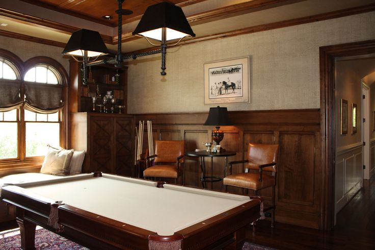 A pool table in a color that matches the room is great for an all guy get away room.
