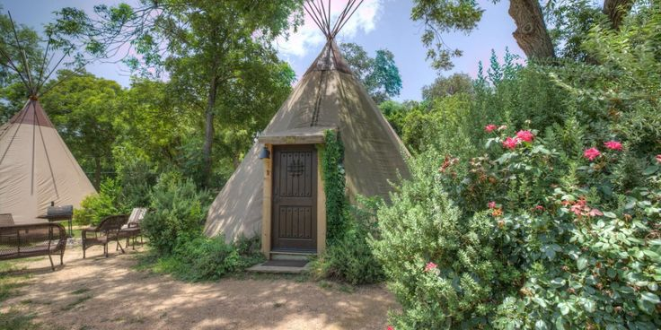 These traditional yet modern tipi rentals in New Braunfels, Texas, allow guests to have a completely unique luxury camping experience. Everyone is talking about luxurious camping in a tipi! There are 5 in all surrounding a stock tank located on the back portion of the property. The tipis look traditional from the outside but inside they are fully furnished and cozy with all modern conveniences including air conditioning, satellite TV, kitchenette with sink, under-counter refrigerator…