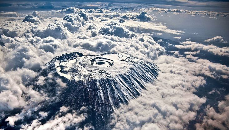 Rare aerial photo of Mount Kilimanjaro, the dormant volcano that is the highest point in Africa, taken by photographer Kyle Mijlof from 60,000ft.