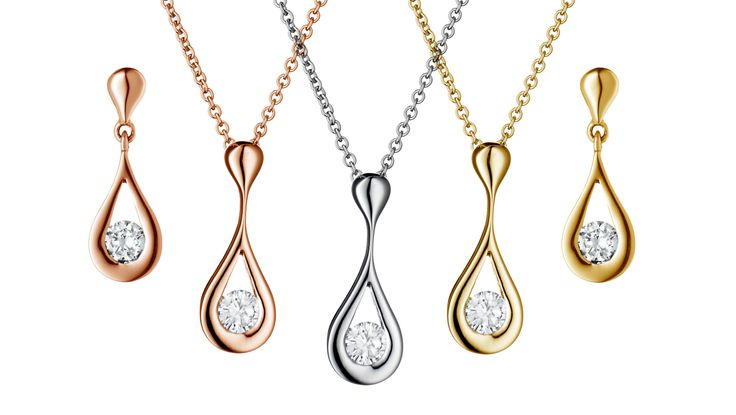 Petal Drop by Simon Pure Jewellers. A floral design cradling brilliant cut diamonds, an effortless flash of radiance in a timeless design. Available in 18ct white, yellow and rose gold. simonpure.co.uk