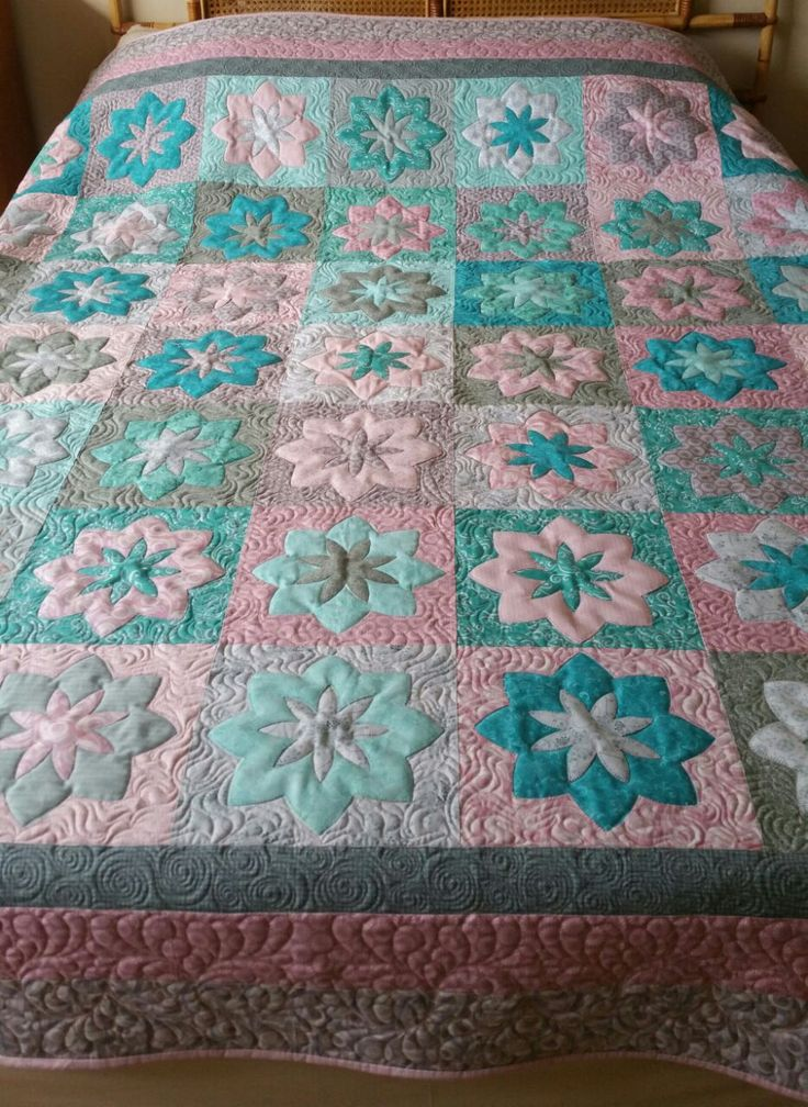 Pieced and appliqued by Sue Marrs.Quilted by Merle Gilson.