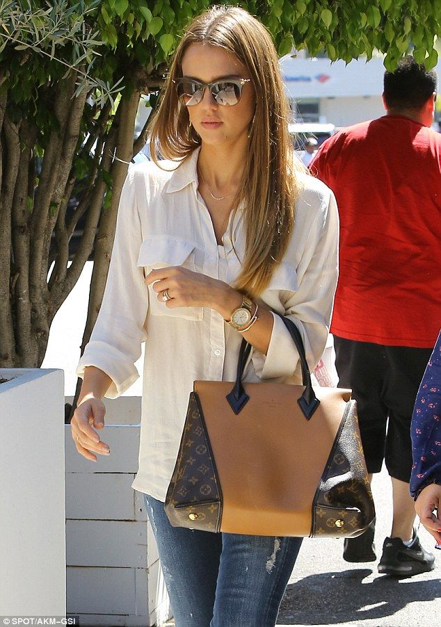 Super stylish: Jessica Alba let her long lightened brown hair down