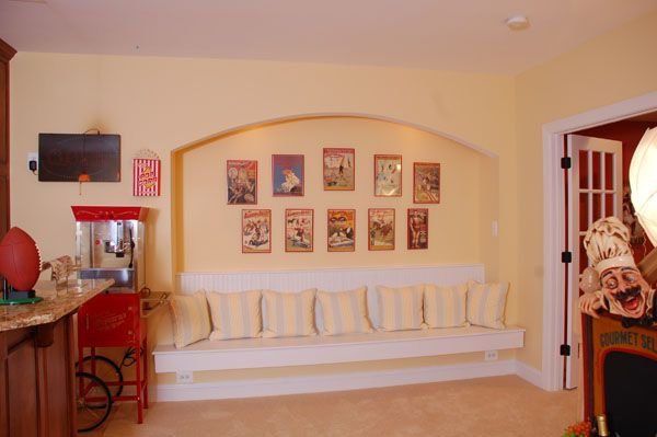 The recessed arched built in bench seat features his framed baseball poster collection.