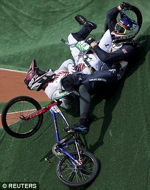 Maris Strombergs (LAT) of Latvia and Liam Phillips (GBR) of Britain crash during heat 2