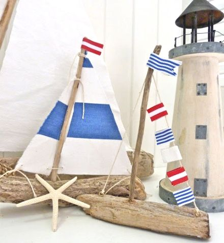 40 Nautical Crafts for the Home, including #patriotic #driftwood boats with red, blue and white sails.