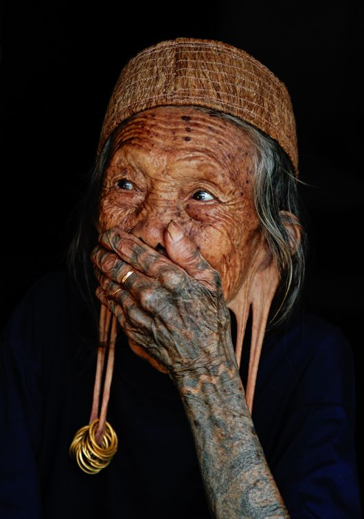 Old woman from Dayak Kenyah tribe in East Borneo, Indonesia. Women with long earlobes in Dayak Kenyah tribe are considered noble and respectable, while nowadays the tradition is no longer common among the tribeswomen. Photo by Harjono Djoyobisono