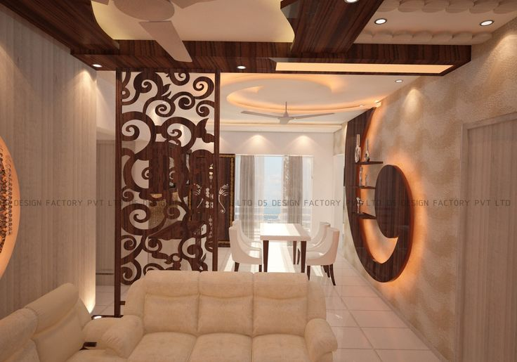 The living room was completed with off white lounge seating. In the dining area the centre of attraction was the white surfaced dining table with white chairs and the display unit in teak finish with a unique curved flowery motif.