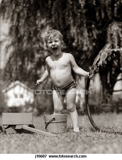 playing out back with water hose 1950S Wet Young Boy Toddler Outside Playing With Water Hose j10687 - Search Stock Photography, Photos, Prints, Images, and Photo Clipart - j10687.jpg