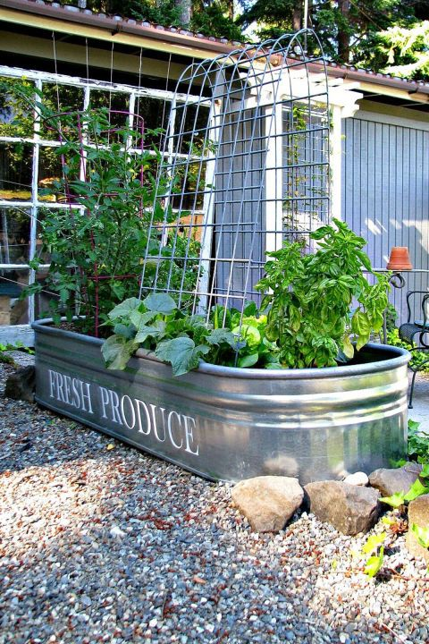 Does a big sprawling garden sound unmanageable? Keep things contained and compact by using a galvanized feed trough as a raised gardening bed. Get the tutorial at Blue Roof Cabin.