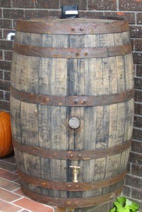 Kentucky Bourbon Rain Barrel. Would love to have one of these as a yard accent!