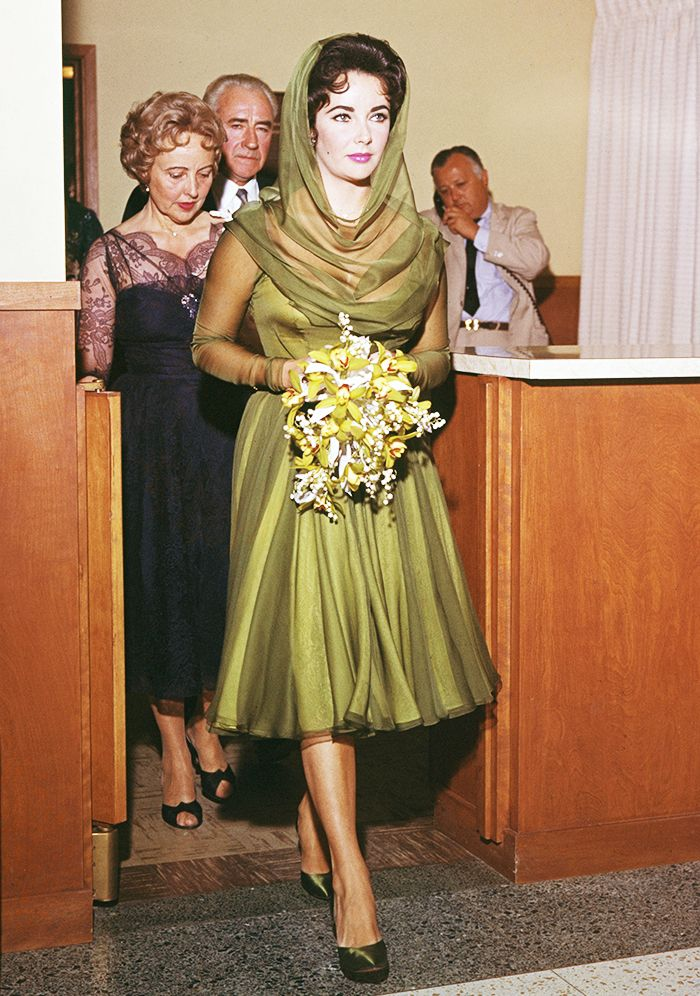 Elizabeth Taylor in a green silk dress with a statement-making hood