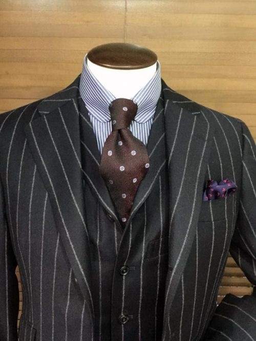 """Notice how smart a finish is given by a simple detail like a single button collar behind a tie knot. The chalk striped suit is VERY """"Chi-town"""" as well."""