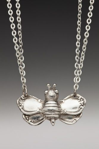 bee's wings were inspired by the ends of antique demitasse sugar spoon handles from the late 1800s