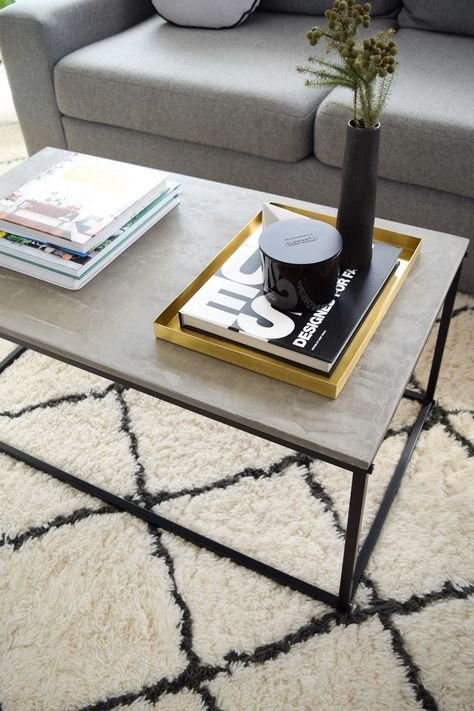 Kmart industrial coffee table hacked with a concrete top.