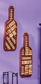 Wine Bottle Wall Mounted Cork Holders for $63.00 from WineRacks.com  These wine bottle shaped cork holders will liven up the decor in any space. A large number of cork holders can be placed inside these wooden frame and can be hung on the wall or used to close wine bottles tightly.