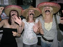 Nothing more hilarious than a fake mustache :) Think Mexican senoritas and western outfits.
