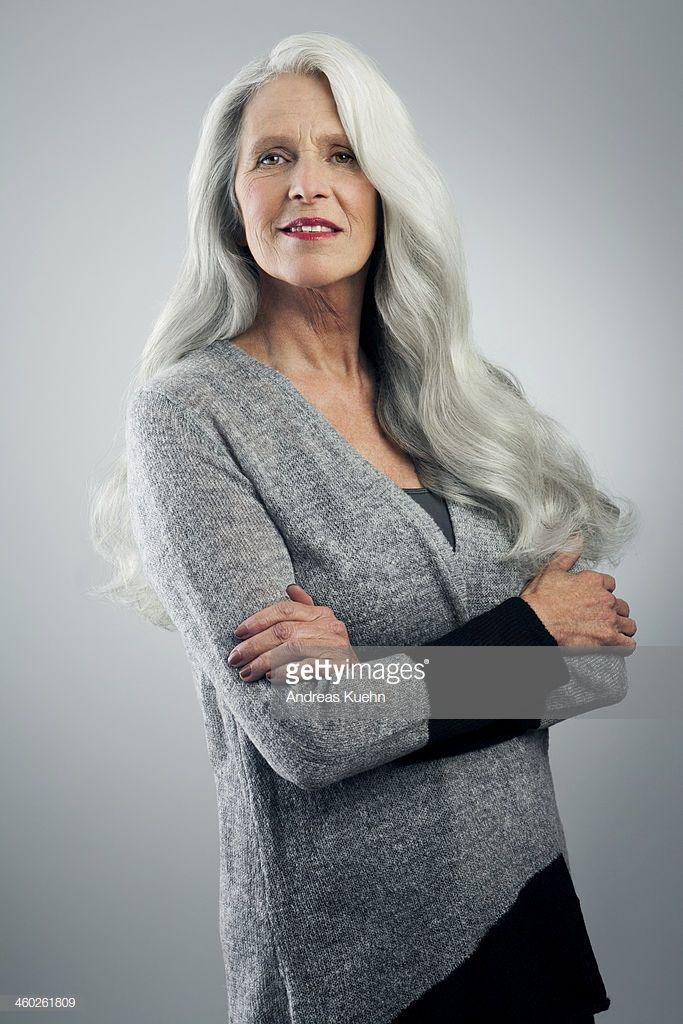 Nude Gray-haired Female Model Posing On White In Studio