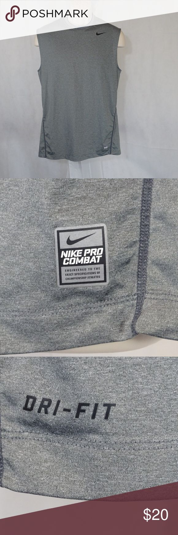 Nike Pro Combat Dri-Fit Fitted Muscle Shirt Large ITEM DESCRIPTION:  Nike Pro Combat Dri-Fit Fitted Muscle Shirt  Men Size: L  Color: Grey  Pattern: solid  Sleeve Length: sleeveless  Closure: pullover  Fabric: 84% Polyester 16% Spandex  Made in: Mexico  ITEM CONDITION:  Pre-owned…Great Used Condition!  ITEM MEASUREMENTS (Laying flat):  Chest (Armpit to Armpit): 20.5 in  Back Length: 29 in Nike Shirts