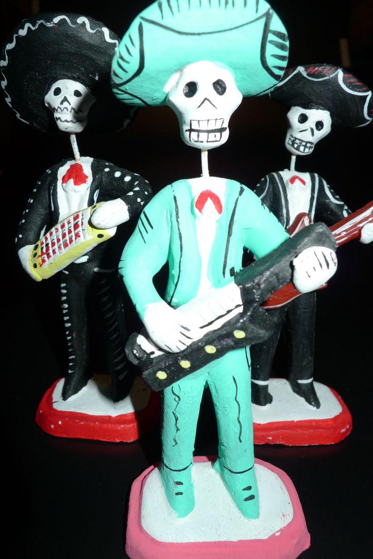 Dia de Muertos skeleton orchestra wearing sombreros -close up.