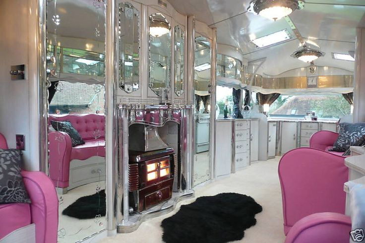 cozy fireplace in a glam trailer - go back into this one and you can find the original page for Desperate for a vintage trailer.. so many to choose from.