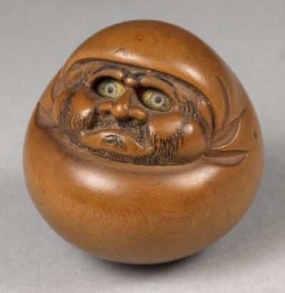 Netsuke Japanese carved boxwood netsuke of a Daruma doll, with ivory inset
