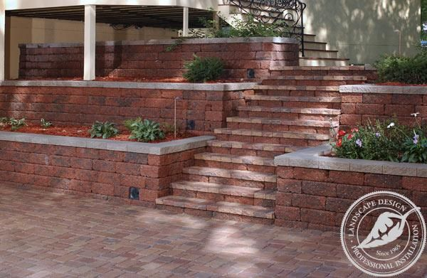 Terraced retaining walls along with stairs leading to a for Patio and retaining wall ideas
