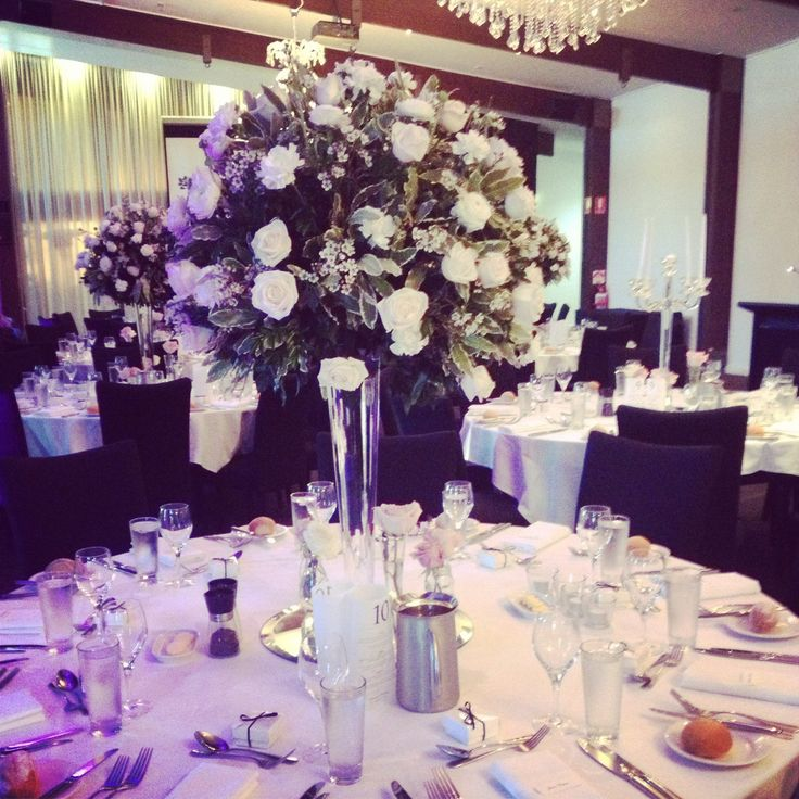 Gorgeous rose flower ball with our pilsner vases!