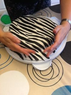 Putting the stripes on the white fondant before you cover the cake....hmmm, never thought about doing it in that order.