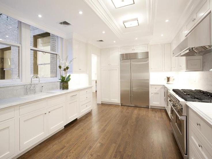 new york city apartment kitchen white cabinets hardwood wood