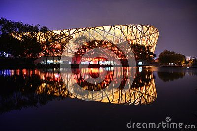 The Beijing National Stadium, also called the bird's nest, is at the 2008 Summer Olympics construction, is the opening and closing ceremonies of the place, this is my night shoot, the river appeared on the bird's nest at night reflection, next to it is very beautiful. The bird's nest will be the 2022 winter Olympics Museum home court.