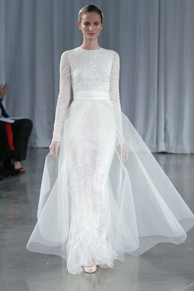 I'm looking for a design to my gown. It should be with a conservative cut. Long sleeves preferably and high collar.