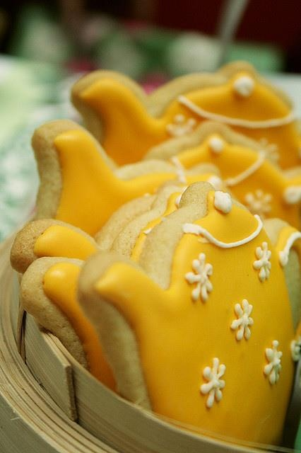 Sugar cookies cut-out in the shape of little teapots. Orange glazing. Adorable in any color, along with cookies in the shape of tea cups!