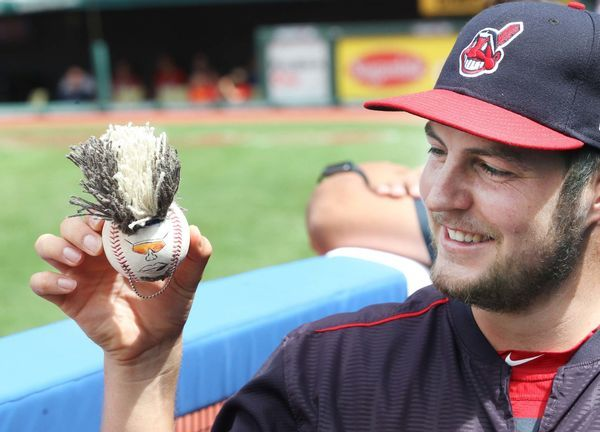 Cleveland Indians Trevor Bauer holds the 'Mini Jose' baseball that he made with Carlos Carrasco for teammate Jose Ramirez, during the game against the Los Angeles Dodgers at Progressive Field, Cleveland, Ohio, on June 15, 2017. (Chuck Crow/The Plain Dealer). Indians won 12-5