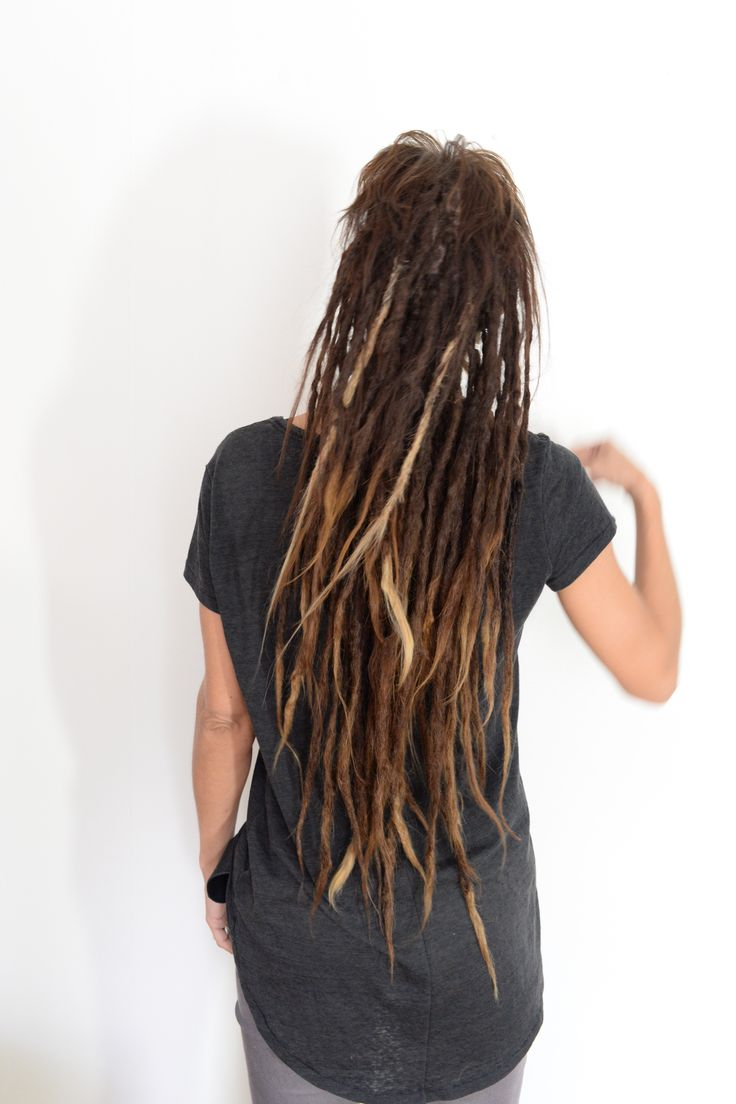 This is my client lina, I've been following her dreadlock Journey for years, she started with two behind her ear and we keept on adding more and more. Look at this lushes head of dreadlocks that she has now. Amazing!