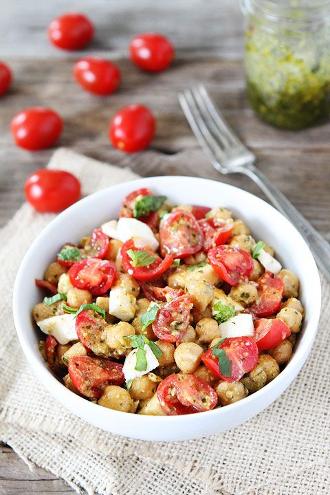 Chickpea, Pesto, Tomato, and Mozzarella Salad Recipe on twopeasandtheirpod.com Love this easy and healthy salad! #salad #summer