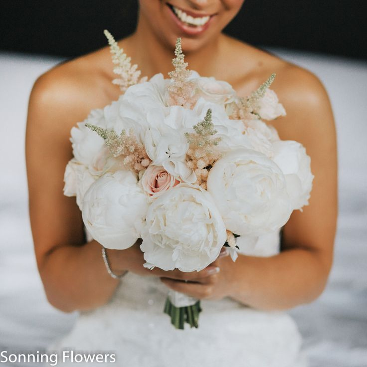 Elegant, soft and romantic bouquets including roses (Sweet Avalanche, White O'hara, avalanche & Quicksand), white hydrangea, very pale pink peonies, pale pink astilbe, white stocks and pale pink spray rose. Created by Sonning Flowers.
