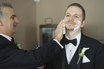 Groom getting a shave on wedding day.  #torontoweddingphotography #torontoweddingvideography #weddingphotography #torontoweddings #torontowedding #culturalwedding #torontophotographer #torontovideographer #weddingvideography #torontobride