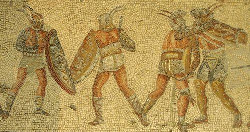 Gladiators fight, Mosaic of the Gladiators, Jamahiriya Museum, Tripoli, Libya. From Dar Buc Ammera villa (Zliten). More information: More information: Wikipedia.
