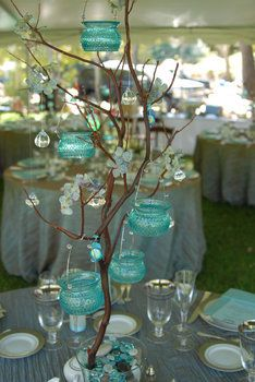 Great centerpiece- branches with hanging aqua jars with tea lights and dainty crystals.